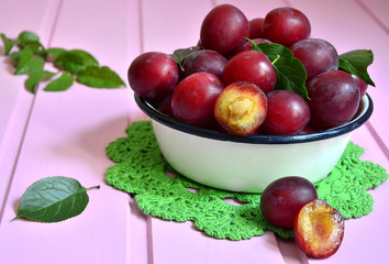 Plum in a white bowl.