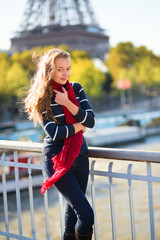 Young girl in red scarf on a fall day in Paris