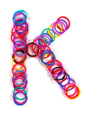 "Colorful rubber band character ""K""."