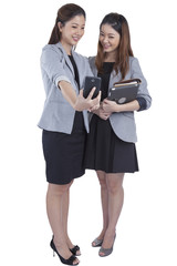 Young businesswomen taking self portrait
