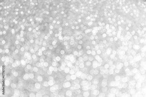 Grey light festive bokeh defocused abstract background.