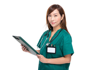 Medical doctor with notepad