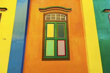 Colorful windows and details on a colonial house in Singapore