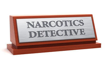 Narcotics detective job title on nameplate