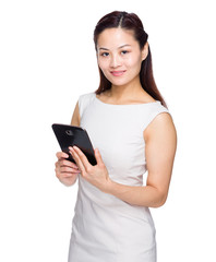 Asian woman reading from tablet on white background