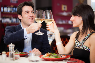 Couple toasting glasses