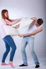 Teenagers fighting with pillows