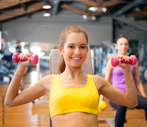 Active woman working out in a gym