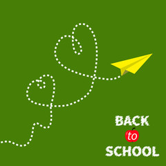 Origami paper plane on green. Two dash heart. Back to school.