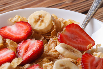 Breakfast muesli with strawberries and banana closeup horizontal