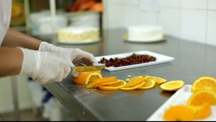 The process of making cakes in a cafeteria