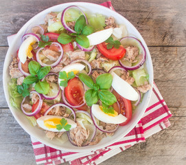 salad with tuna, eggs, tomatoes, onions and basil