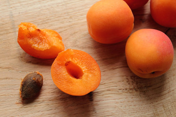 Apricot fruits sliced on a wooden desk