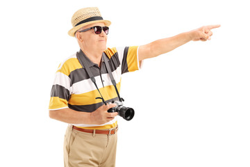 Mature tourist pointing at something with hand
