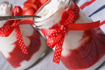 Strawberry yogurt in a jar with a spoon  horizontal