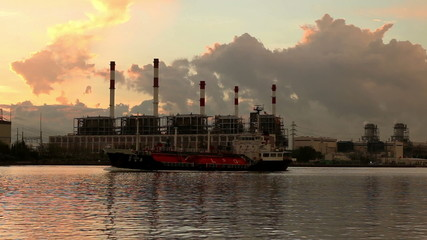 Gas(LPG) tanker at sunrise on electric power station background