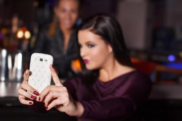 Young brunette woman taking selfie