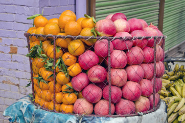 fresh pomegranate and orange fruits in asia market