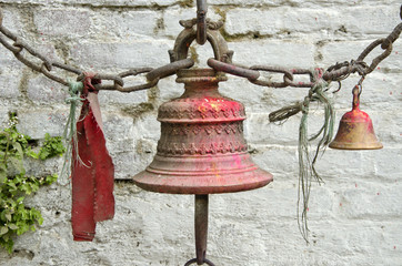 bells near temple wall in Nepal