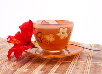 The cup of tea with hibiscus flower