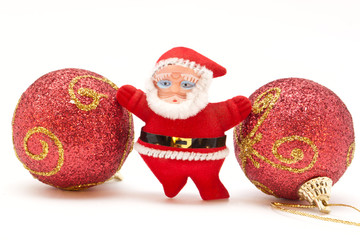 Small Santa Claus toy and Christmas balls