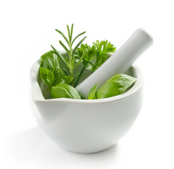green herb leaves in a white pestle