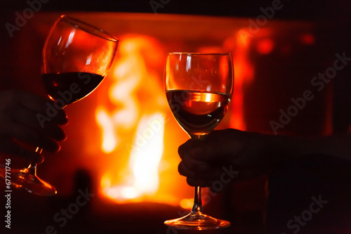 canvas print picture glass of  wine beside the fire