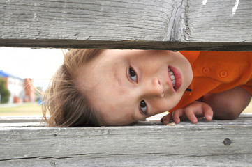 "boy playing game ""hide and seek"""