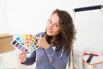 Young woman choosing colors of their new flat