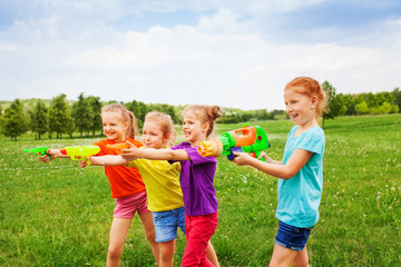 Four children playing with water guns