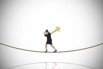 Composite image of wound up businesswoman gesturing on tightrope