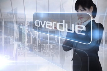 Businesswoman looking at the word overdue
