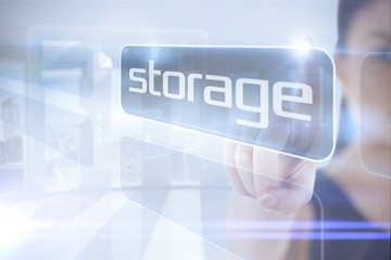 Businesswoman pointing to word storage
