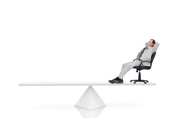 White scales measuring businessman in swivel chair