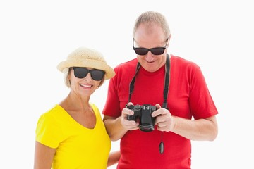 Happy mature couple wearing sunglasses
