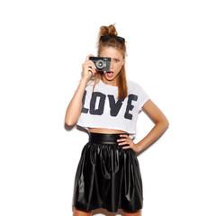 Young woman making photo using noname retro camera