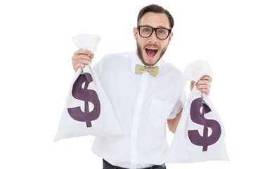 Geeky businessman holding money bags