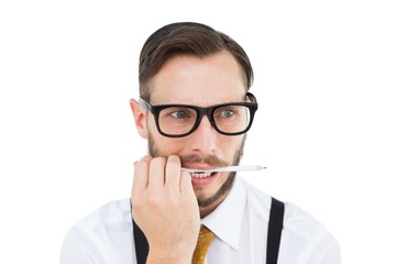 Geeky hipster biting on pencil