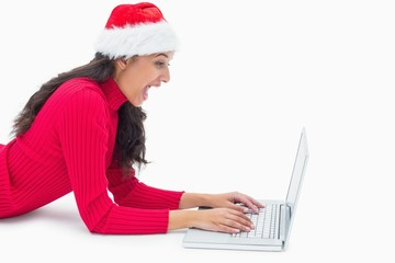 Beautiful festive woman typing on laptop