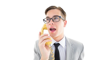 Geeky businessman talking on retro phone