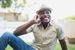 Smiling man relaxing in his garden talking on phone