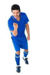 Happy football player in blue celebrating