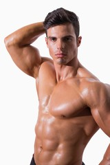 Portrait of a young shirtless muscular man