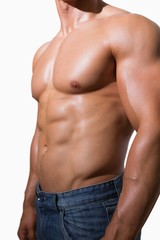 Mid section of a shirtless muscular man