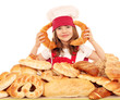 happy little girl cook with breads and rolls
