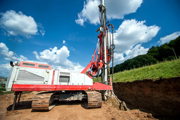 industrial machinery for drilling holes in the ground