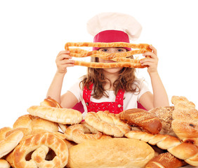 little girl cook with breads pretzels and buns