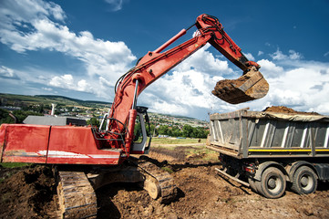 Industrial excavator loading soil from construction site