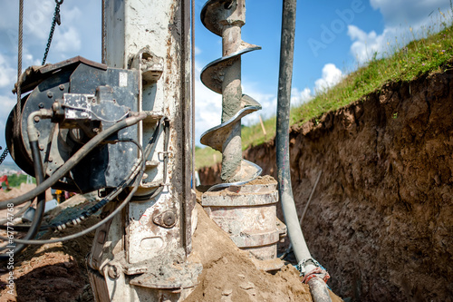 Close up of auger, industrial drilling rig making a hole - 67774768