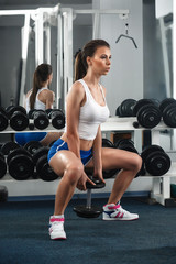 Sporty woman in gym